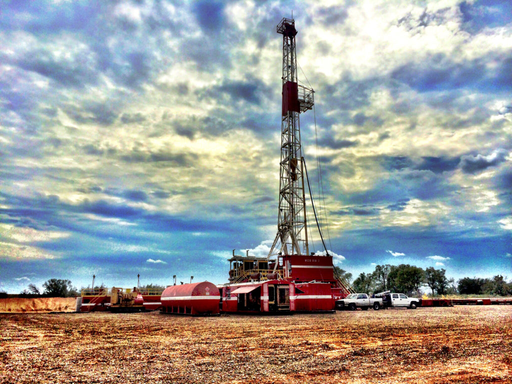 Rig #3 in use by MCG Drilling & completing LLC at an oil drilling site.
